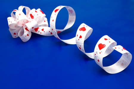 Bow and ribbon with hearts on blue  photo