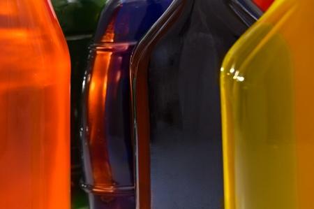 liquids: Glass bottles with different colored liquids.