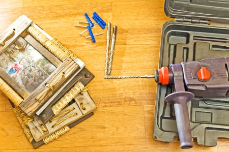 perforate: Hammer drill and the wooden frames. Stock Photo