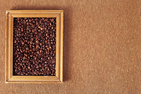 coffee beans in a retro photo frame on textured background photo