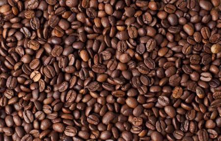 Background with many roasted coffee beans