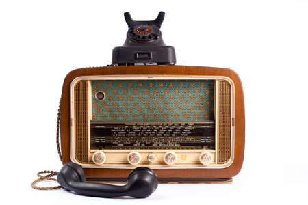 Old phone with an old radio on a white background photo