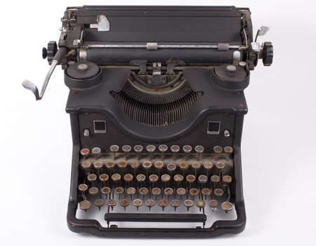 typewriting machine: old typewriter on a white background