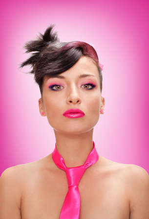 singular: pretty girl with pink tie and pink makeup looking at camera Stock Photo