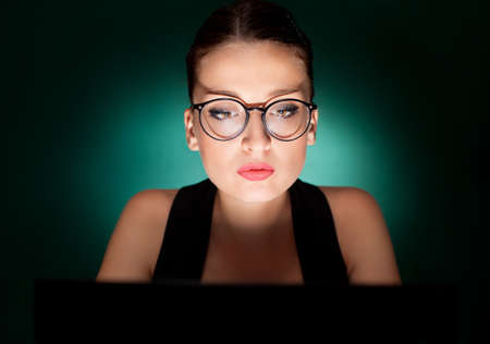attractive bussines woman with eyeglasses using a laptop photo