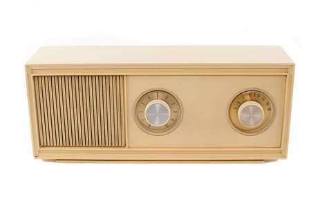 retro beige colored radio isolated on white photo