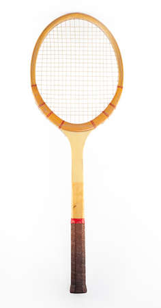retro wooden tennis racket isolated on white background photo