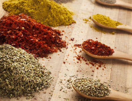 various spices on cutting board with shallow depth of field photo