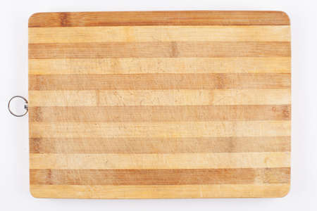 scratched old cutting board isolated on white Stock Photo
