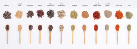 spoon yellow: warious colorful spices on spoons isolated on white background Stock Photo