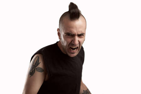 young man with tattooes and mohawk hair shouting,isolated on white Stock Photo - 15976622