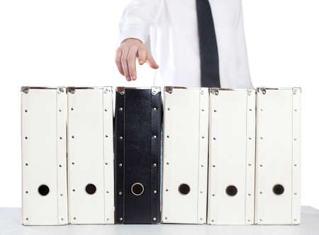 organised: business man is reaching the file folders.isolated on white Stock Photo