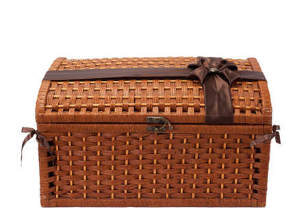 wicker chest wiÅŸth brown ribbon isolated on white photo