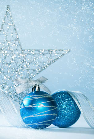 blue christmas background design with ornaments.shallow depth of field photo