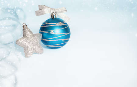 christmas background with christmas star and ball.shallow depth of field with focusing top of the ball