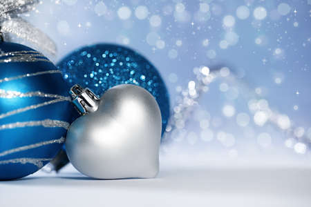 christmas background with various ornaments and light bokehs and sparkles  photo