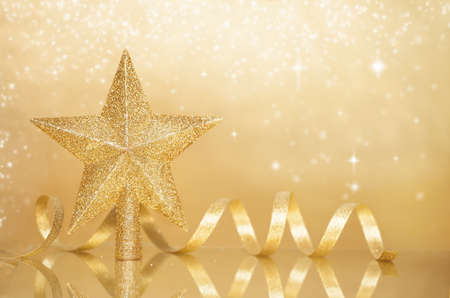 christmas background design on a shiny surface with a star and ribbon photo