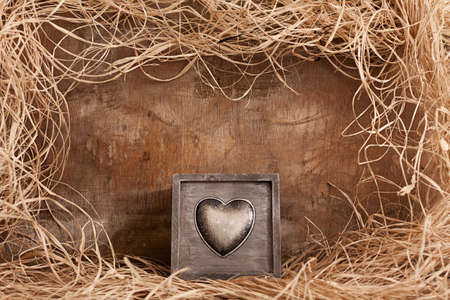 handmade present wooden box with a heart figure on grunge background photo