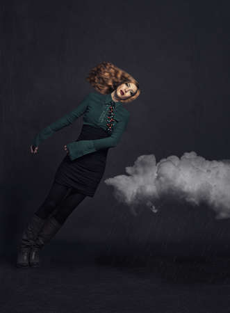 beautiful red haired girl falling down on the clouds.manipulated photo