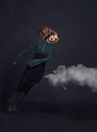 red haired girl: bella ragazza dai capelli rossi che cadono gi� sul clouds.manipulated