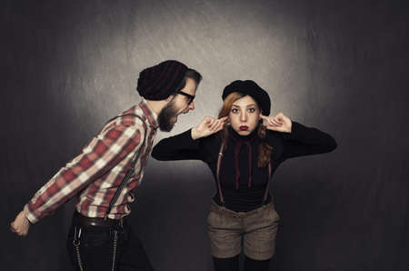 young nerdy girl not listening young nerdy man shouting on grunge background photo