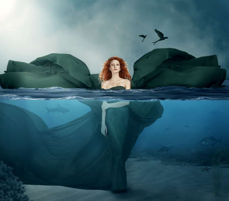 blowing bubbles: beatiful red haired goddes standing in the water.manipulated.