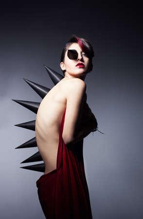 metamorphosis of a young beautiful woman on dark backgorund photo