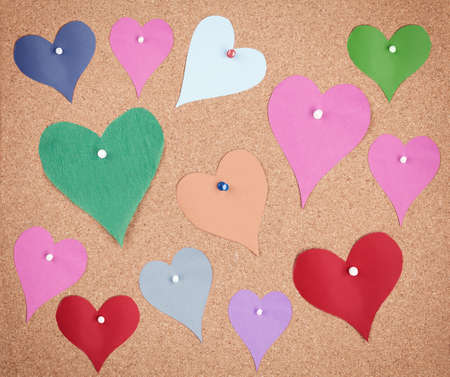colorful hearts made of papers pinned on corkboard