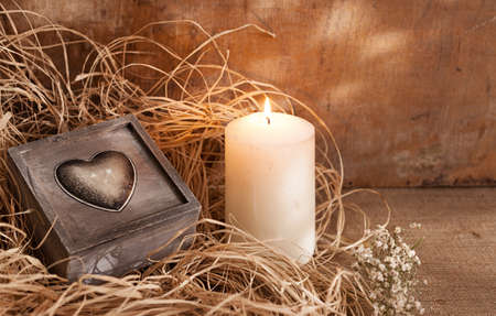 romantic concept with retro gift box and a candle.still life Stock Photo