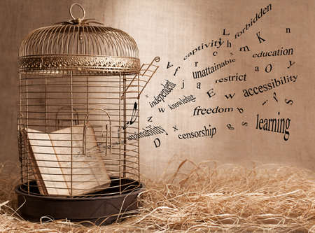 censorship: censorship concept with a book and a birdcage on grunge background Stock Photo