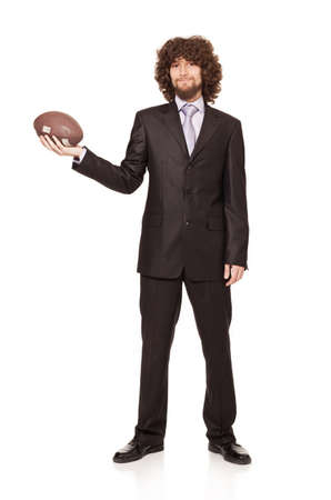 young businessman holding a ball and smiling isolated on white background photo