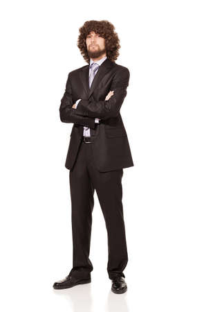 businessman with crossed arms,afro style hair and beard in a suit looking at camera isolated on white background Stock Photo - 18616541