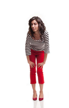 capri pants: young pretty woman in casual clothes posing and looking at camera isolated on white