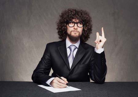afro style haired businessman raising his finger and thinking on grunge background Stock Photo - 18617342