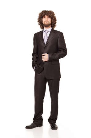 young businessman wearing a chic suit posing and looking at camera isolated on white background photo