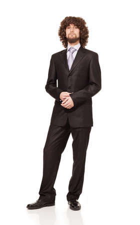 confident young businessman with afro hair in suit looking at camera isolated on white background photo