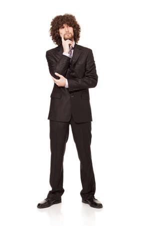 young businessman trynig to make a decision isolated on white background Stock Photo - 18616520