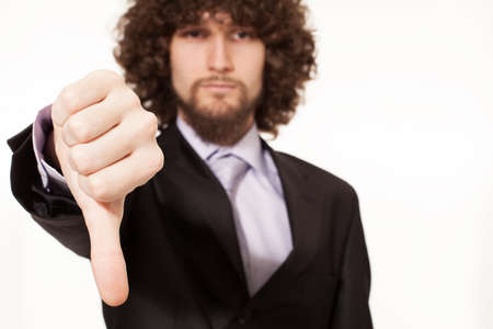 young afro style haired businessman with thumb down isolated on white background Stock Photo - 18616994