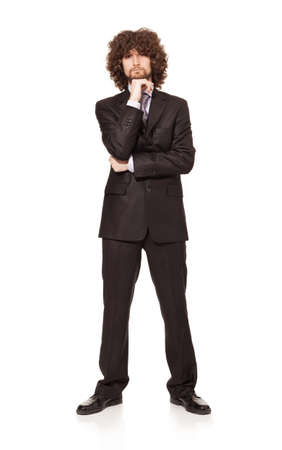 man with long hair: handsome young businessman posing and looking at camera isolated on white background Stock Photo