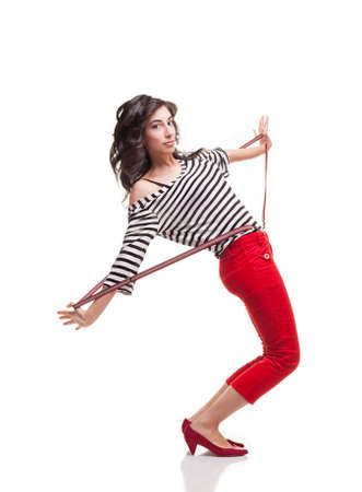 capri pants: young lady pulling her braces and wearing casual clothes looking at camera and posing isolated on white Stock Photo