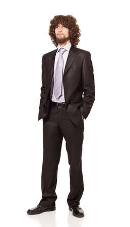 young businessman wearing suit and his hands in his pockets looking somewhere isolated on white background Stock Photo - 18616928