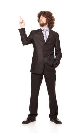 young businessman showing something with his forefinger isolated on white background Stock Photo - 18616521
