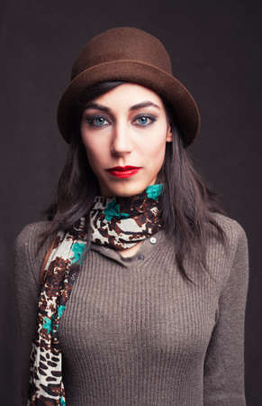 turkish woman: portait picture of a beautiful young model with blue eyes on grunge background Stock Photo
