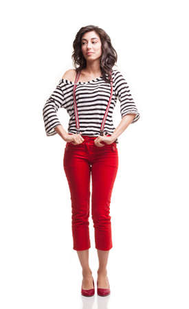capri pants: young lady with red capri and striped blouse looking her right isolated on white