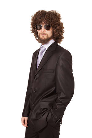 young afro style haired businessman wearing sunglasses isolated on white background photo