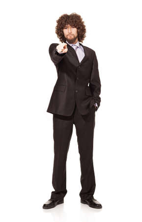 young serious businessman showing and wanting you isolated on white.finger focused photo
