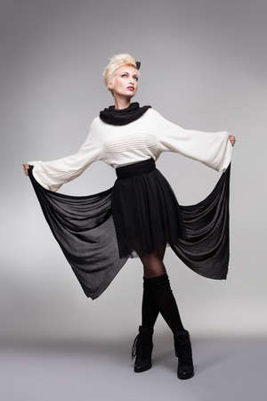 hairclip: beautiful model holding her dress like a buıtterfly wing on gray bakcground Stock Photo