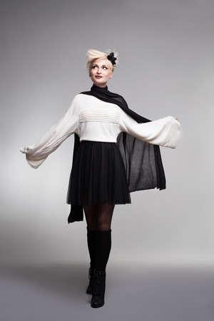 long socks: blonde beautiful fashion model posing on grey background Stock Photo
