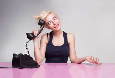 dummy secretary with punk style hair trying to answer the phone Stock Photo - 18617654