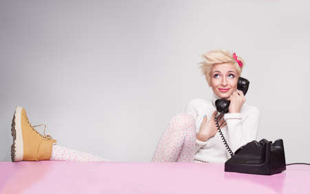 happy young lady having conversation with her boyfriend on the phone Stock Photo - 18617514